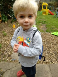 Proud of his new bag and haircut, ready for nursery.