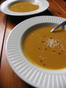 dairy free creamy sweet potato and coconut soup with honey and cinnamon