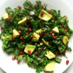 Warm kale, pomegranate & avocado salad